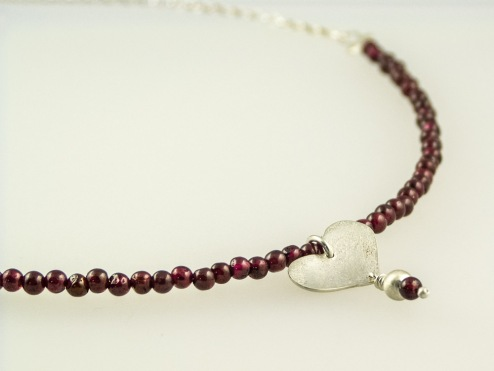 garent and silver heart necklace