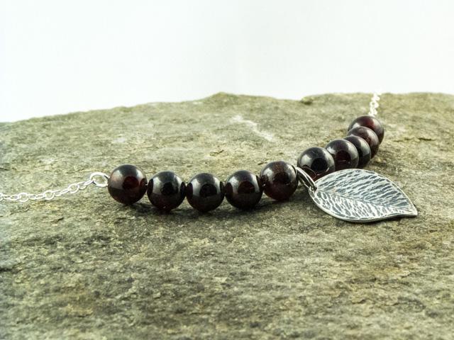 Garnet and silver leaf necklace