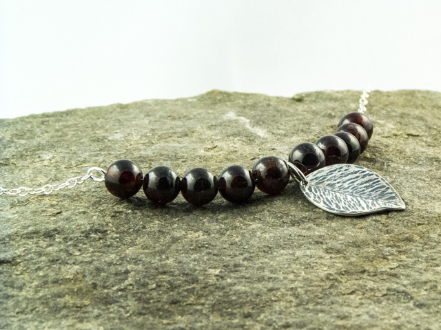 Garnet and silver leaf necklace